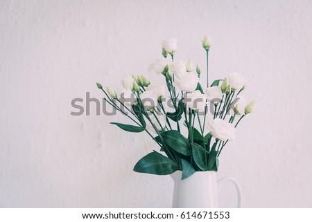 White roses in vase  - Shutterstock ID 614671553