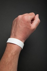 White round bracelet on hand, mockup. Arm wristband accessory adhesive blank.