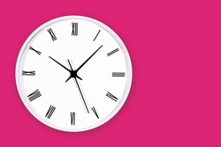 White round clock with black arrows and numbers on pink wall. Time symbol background. Hours and minutes texture. Empty copy space isolated clock. Daily hourly routine backdrop.