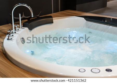 White round jacuzzi with swirling water in the bathroom Photo stock ©