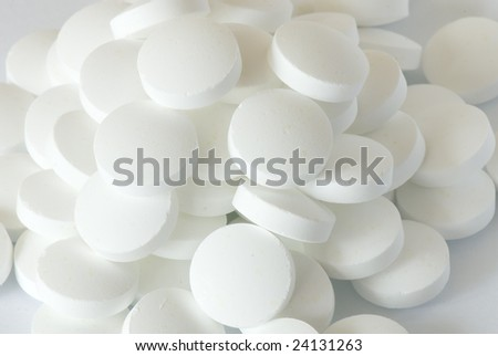 white round pill on the white isolated background - stock photo