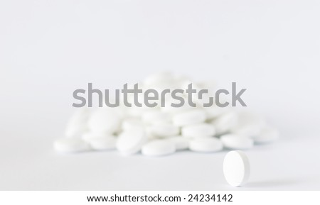 stock-photo-white-round-pill-on-the-white-isolated-background-24234142 ...