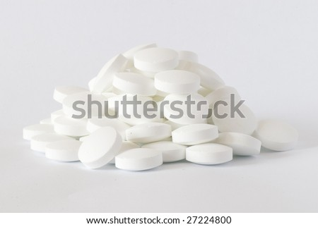 white round pill on the white isolated background