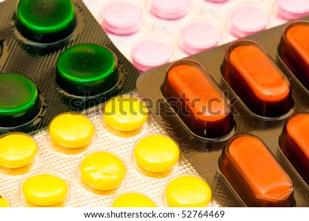 white round pills on the white isolated background