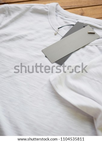 White round t-shirt and clothing label  #1104535811