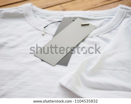 White round t-shirt and clothing label  #1104535832