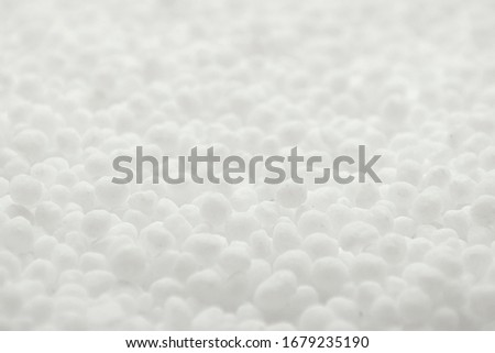 White round urea fertilizer closeup. Chemical fertilizer carbamide. Mineral fertilizers are white balls of carbamide (urea). Background, texture.