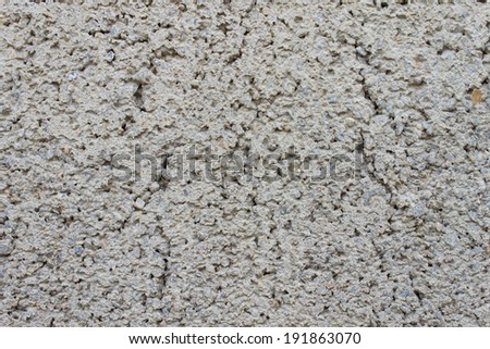 White rugged cement background that consist of small sand and stone. Concrete texture for grunge or old design