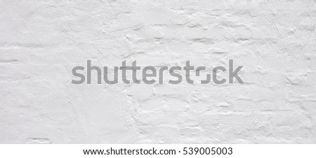 White Rustic Brick Wall Texture. Retro Whitewashed Old Brickwork Surface. Vintage Bricklaying Structure. Grungy Shabby Uneven Painted Plaster In Whiten Facade Background. Abstract Web Banner.