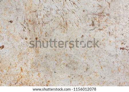 white rusty surface. Rusty background. A rusty old metal plate with cracked white gloss paint. Rusty White Metal Texture