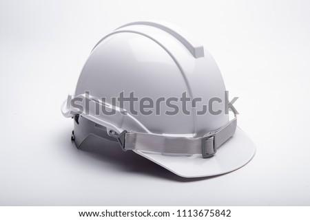 White safety helmet construction on white background #1113675842