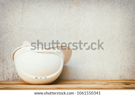 Photo of  white safety helmet plastic construction of engineering on wood floor table background vintage scratched old film colors. with copy space add text