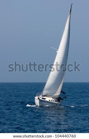 White sailboat underway