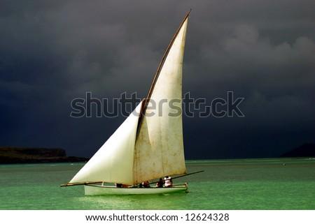 White sailed pirogue on the ocean (Mauritius)