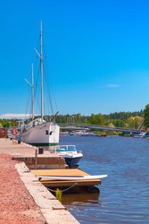 White sailing ship is moored in marina of the old town of Porvoo, Finland