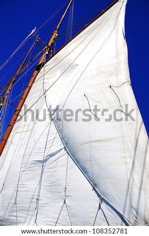 white sails of yachts and blue sky