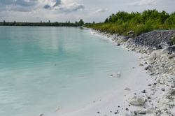 white sand and cyan colored water in artificial ash ponds near Nazarovo disrtict power station (Krasnoyarsk Krai, Russia)