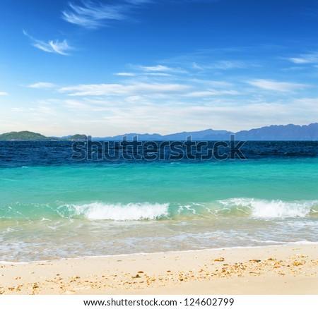 White sand beach and blue sky. Coron, Busuanga island, Palawan province, Philippines.