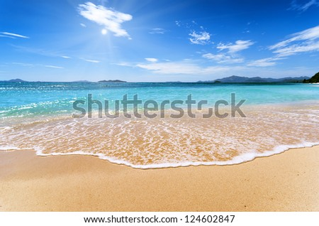 White sand beach and blue sky. Coron, Busuanga island, Palawan province, Philippines. - stock photo