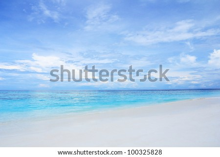 White sand beach and clear blue sea with beautiful sky