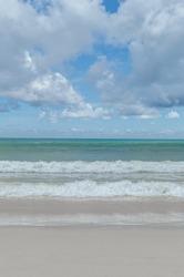 White sand beach, blue sky and wave