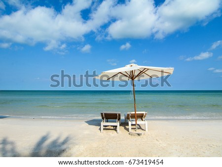 White sand beach with relaxing chairs at sunny day in Phu Quoc Island, Vietnam. #673419454