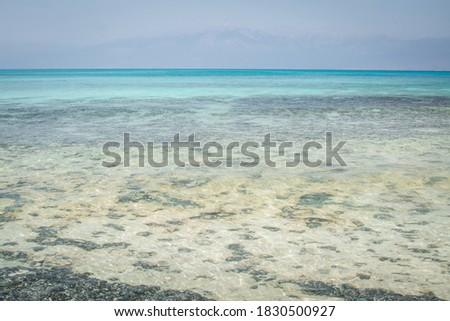 white sand,blue water,boat,beach ,Chrissi island.Greece