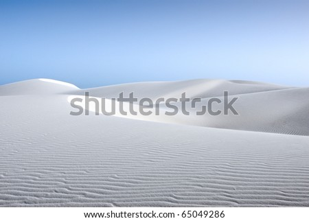 white sand dune and blue sky - stock photo