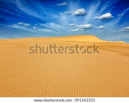 White sand dunes in desert on sunrise, Mui Ne, Vietnam.