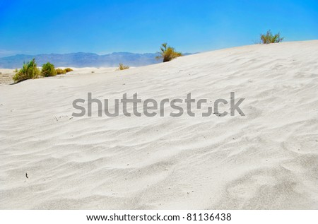 White sand dunes under blue sky, Death Valley, California