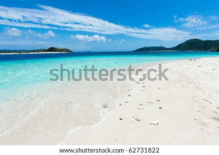White sand paradise beach on the deserted tropical island in the coral reef lagoon with clear blue sea, Zamami Island of Kerama Islands, Okinawa, Japan