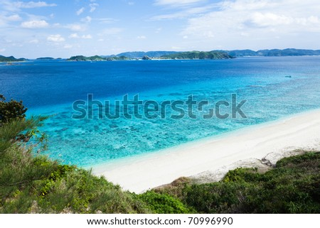 White sand tropical beach and coral reef with horizon over clear blue water, Kerama Islands, Okinawa, Tropical Japan
