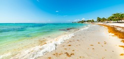 White sand, turquoise sea and blue sky in Raisins Clairs beach in Guadeloupe, French west indies. Lesser Antilles, Caribbean sea