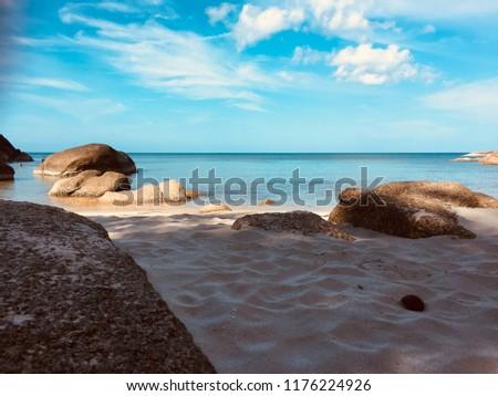 Stock Photo White sandy beach rock whit blue sky clouds ocean view