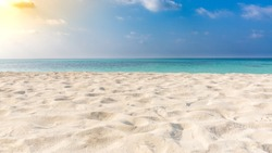 White sandy tropical beach and soft sunlight background and banner