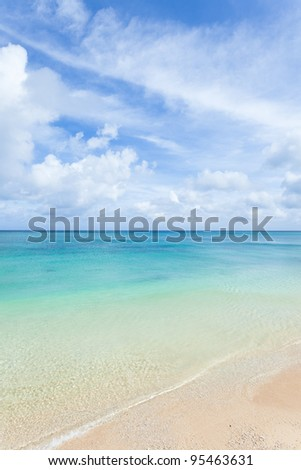 White sandy tropical beach with crystal clear blue lagoon water, Okinawa