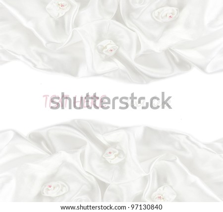 White satin fabric roses and a white background
