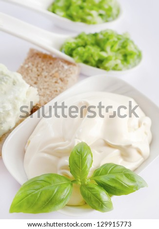 White sauce with basil leaves
