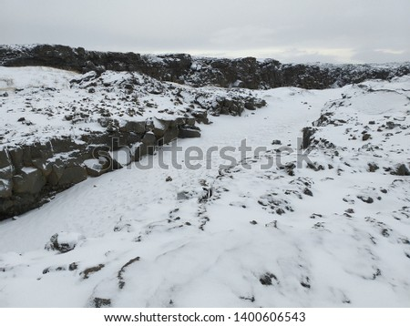 White scene of snow cover a rift valley at the boundary of the two continental tectonic plates beneath the Earth's crust meet – the North American plate to the west and the Eurasian plate to the east #1400606543