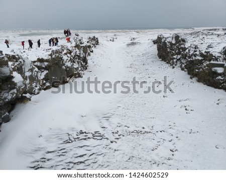 White scene of snow cover a rift valley at the boundary of the two continental tectonic plates beneath the Earth's crust meet – the North American plate to the west and the Eurasian plate to the east #1424602529
