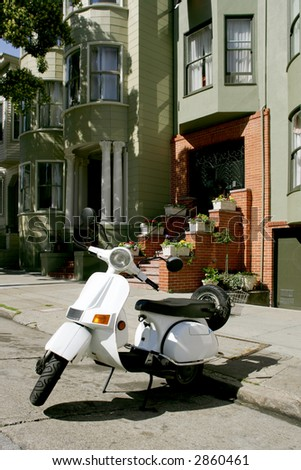White scooter parked in front of Victorian houses in San Francisco