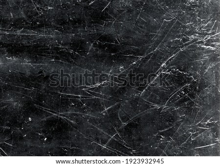 White scratches and dust on black background. Vintage scratched grunge plastic broken screen texture. Scratched glass surface wallpaper. Space for text Stock photo ©