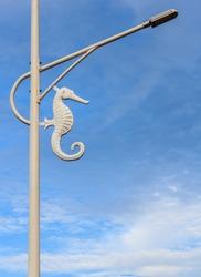 White sea horse street lamp in blue sky background