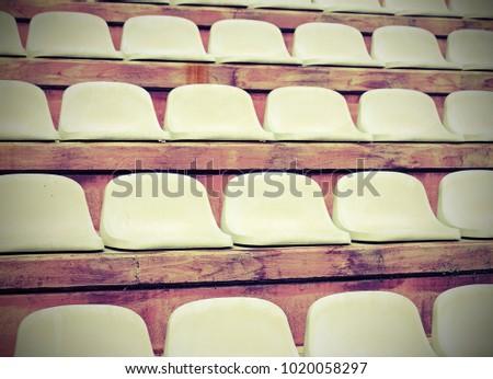 white seats on stadium...