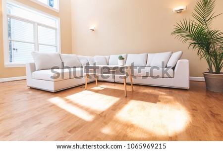White sectional couch in a large luxury interior home #1065969215