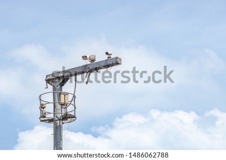 White Security Camera Record Observation on Urban Exterior Pole Concept, Digital Technology Safety Street or Traffic Control for Management, CCTV Monitoring for Monitoring with Sky Background #1486062788