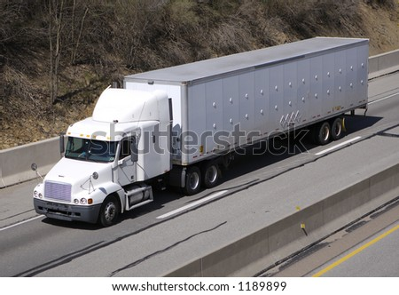 White Semi Truck on the Highway