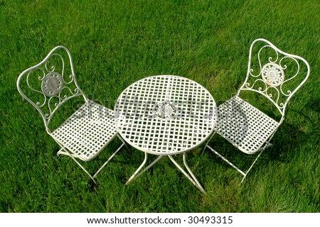 White Shabby Chic Cast Iron Outdoor Patio Furniture Set On Green Grass Lawn  Outside