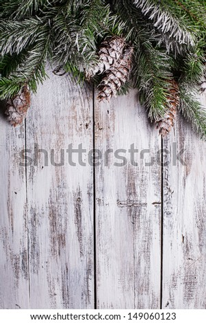 White shabby Christmas border with snow covered pinecones #149060123