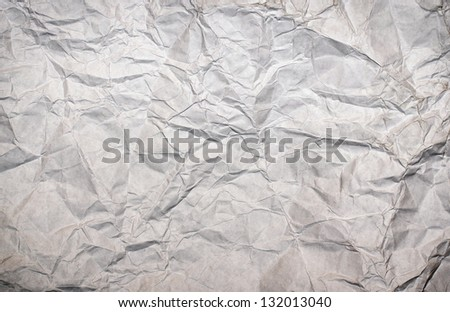 White sheet of crumpled paper.
